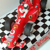 Ferrari F1 Race Car Birthday Cake By Charmpastry Yikes, the 40 hand-piped corporate logos almost killed me!Inside, chocolate cake, raspberry & vanilla mousselines. Rice Krispie tires....
