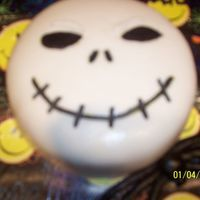 Kia's 14Th Birthday Cake I used 2 - 8 inches rounds of chocolate cake with coconut filling. My daughter LOVES Nightmare Before Christmas & Jack Skellington!!...