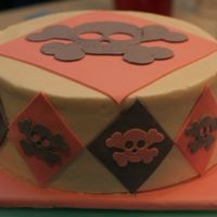 Skull And Crossbones  The cake my niece helped me decorate for her birthday. I iced the cake and cut the skull and crossbones. She cut the diamonds and placed...