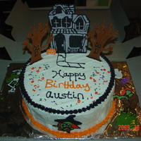 Haunted House Halloween Birthday Cake The haunted house, scary trees, zombie, skeleton, etc are all made out of royal icing.