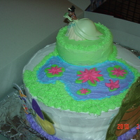 The Princess And The Frog Alligator and lightning bug are made of royal icing. Made this cake for my nieces.