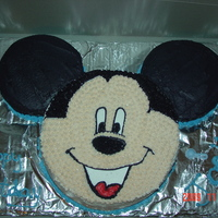 Mickey Mouse Cake Vanilla cake with butter cream icing.