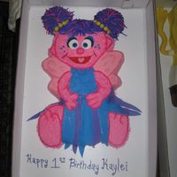 Abby Cadabby Shaped Abby Cadabby cake for first birthday girl. Buttercream with fondant accents.