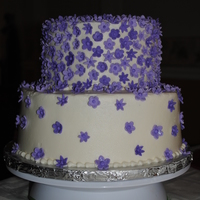 Purple Flowers BC with about 400 gumpaste/fondant mix flowers. Time consuming but fun.