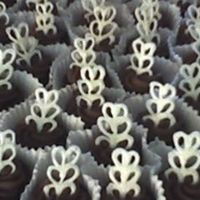 Sea Of Brownies! These were for my future daughter-in-law's Bridal Shower. They are brownes cut in circleswith whipped chocolate ganache rosettes and...