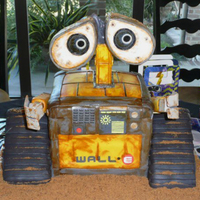 Wall-E For my grandson's birthday. Managed to accomplish this cake with 4 small children running around in the house, so even though it'...