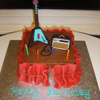 "Rock N Roll Birthday  8in square iced in buttercream. Fondant ""curtain"" around sides, fondant vox amp and wires. Chocolate mold for electric guitar...."