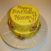 Happy Birthday Honey 5in and 6in round iced in buttercream. Beehives are chocolate molds in peanut butter and chocolate flavor.