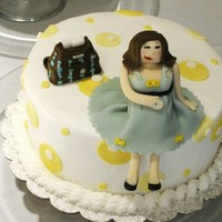 Modern Mommy Cake  8in round iced in buttercream decorated with MMF yellow and white mod circles. Pregnant mommy and Petunia Pickle Bottom diaper bag done in...