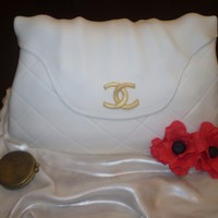 White Chanel Handbag Made this Handbag for my moms birthday. Red Velvet cake with cream cheese filliing.