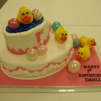 Rubber Duckies First birthday cake for a friend's first grandchild. She kindly only gave me a few requirements, and then let me play: something...