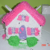 Dollhouse Cake   Made for fun by Kayla and Anika- Wilton House cake pan (buttercream icing, vanilla cake)