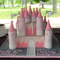 Wonky Pink Castle B-day cake for my neice and her friend for their 2nd birthday. I wanted to make the turrets out of foam covered in fondant, but was unable...