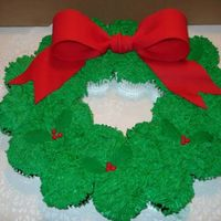 Xmas Cupcake Wreath  I'm a newbie to cake decorating and very pleased with how this turned out. It was for my granddaughter's school party. I...