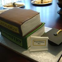 Graduation Cake  My first book cake. Thanks for inspiration & help from CC members. German Choc. cake w/coconut pecan filling. Fondant, gumpaste scroll...