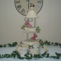 Kassi's Cake This was for a cousin's quinceanera. I had a lot of fun working on this one. Simple yet elegant.