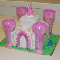 Cinderella Castle   Vanilla cake covered in fondant. I cheated and bought the towers from publix, but I thought they turned out ok. TFL