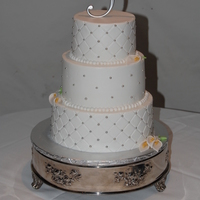 Quilted Wedding Red velvet with buttercreme icing. Silver beads with gum paste cala lillies
