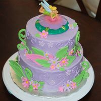 Tinkerbell   I got lots of ideas for this cake from CC website. The topper came from walmart. The rest is BC with fondant accents. TFL