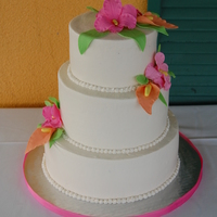 Tropical Flower Wedding Cake   Choco cake with buttercreme icing and gumpaste flowers.