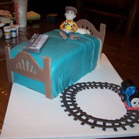Woody Cake A Birthday cake for 3 children, vanilla cake with buttercream and fondant figures of Woody for one child, thomas for another and the...