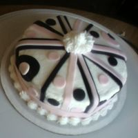 Pink Black White This is just a one layer 8 inch cake in pink and black fondant over white buttercream frosting. Only problem was I forgot to cover the...