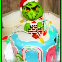 The Grinch Chocolate truffle cake with vanilla buttercream. Grinch is RKT with MMF.