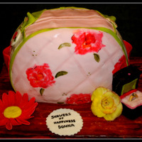 Bridal Shower Purse Chocolate cake with truffle and cookies and cream filling. MMF with hand painted flowers, all decoration fondant.