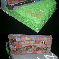 Parking Lot With 3D Wall Gingerbread wall covered in hand-made fondante bricks, then painted with a colour wash to give it a more city-like and worn look. Grass...