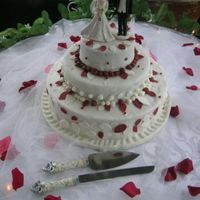 Wedding Cake The theme at the wedding was burgundy-red and white. The bride preferred no flowers so I worked with leaves and assorted ball sizes to fill...
