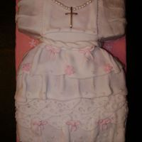 Baptism Dress Fondante-covered and hand made pearls with pearling dust. Cross was real silver and of sentimental value; I was asked to include it into...