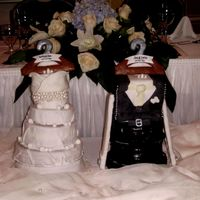 Wedding Cake Bride And Groom Outfits The Bride and Groom's outifts on 'wooden' gingerbread hangers. Everything is edible and this wedding cake was NOT a...