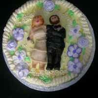 Wedding Shower Cake Marzipan people on a buttercream decorative icing. The cake was a lemon raspberry chiffon.