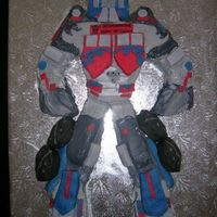 Optimus Prime Cake A very fun birthday cake that I did for my boyfriend. Some of his armor was gingerbread covered in fondante and other areas were cake with...