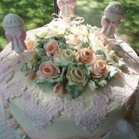 Rattles And Roses Fondant lace and chocolate rattles with buttercream roses