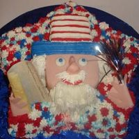 B_1215101253.jpg UNCLE SAM CAKE WITH FONDANT AND BUTTERCREAM. EDIBLE DECLARATION AND HANDS MADE OUT OF FONDANT. INSIDE HAD LAYERS OF BLUE WHIPPED ICING.