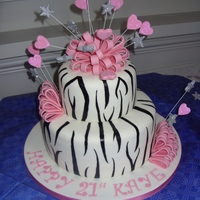 Zebra And Bows A 10 inch and 6 inch vanilla madeira with strawberry and buttercream filling. Gumpaste bows and stars and hearts on wires covered in...