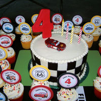 Lightning Mcqueen Birthday Made this for my son's Lightning McQueen birthday party. The cake covered in buttercream and black fondant squares. Made the cupcake...