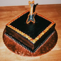 Ty's Guitar Cake... They didn't have the budget for a guitar shaped cake so I thought this up, sorry the pic is bad our digital is broken, this is a...