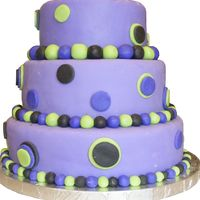 Purple Polka Dot My first tiered cake. Made with Marshmallow fondant.