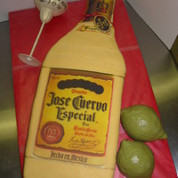 Tequilla Bottle Red velvet cake with white chocolate ganache, covered in MFF. Glass made out of gumpaste and limes are styrofoam balls covered in MFF....