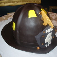 Firefighter's Helmet Groom was a firefighter so bride ordered this grooms cake. It was an exact replica of his helmet. Eagle and shield was gumpaste, the rest...