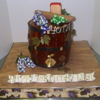Wine Barrel Cake Key lime pound cake filled with lemon curd and SMBC. Covered in MFF fondant. Grapes, bread and cheese made from gumpaste.