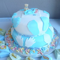 Hands And Feet vanilla cake and icing, cover with fondant, the baby is made of fondant too