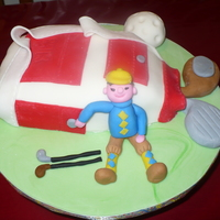 Golf Chocolate cake, vanillaicing, cover with fondant, figure too, got it from Carol Deacon Book
