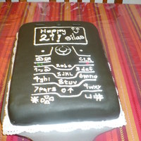 Cell Phone White cake, almond icing, cover with fondant, icing numbers.Made for my brother in law, hi lovehis cell phone.