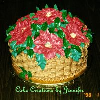 Poinsettia Basket Great centerpiece/dessert for a holiday gethering. Buttercream poinsettia piped right on the cake, gumpaste holly leaves