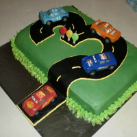 Racing Cars Cake I made this for a friends sons 3rd birthday. He loves the movie Cars. He loved it and apart from a few disasters it was pretty fun.