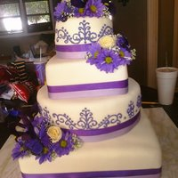Purple Wedding My first time doing scroll work. 14 inch square, 12 inch round, 8 inch square and 6 inch round. Flavors were pina colada, key lime, orange...