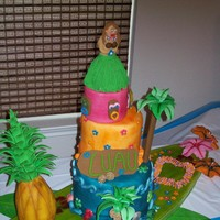 Hawaiian Theme Fondant covered cake with decorations made of gumpaste.
